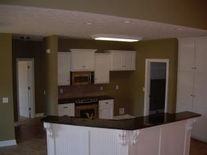 Kitchen has granite counters and upgrade