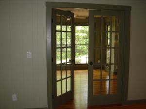 Double doors lead to main bedroom