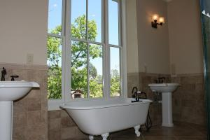 Master bath w claw tub & 2 ped. sinks.