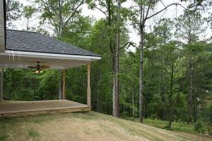 Covered back deck overlooks lake